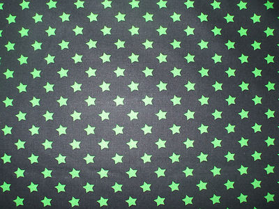 Black with 8mm Green Stars 100% Cotton Fabric