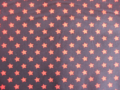 Black with 8mm Red Stars 100% Cotton Fabric